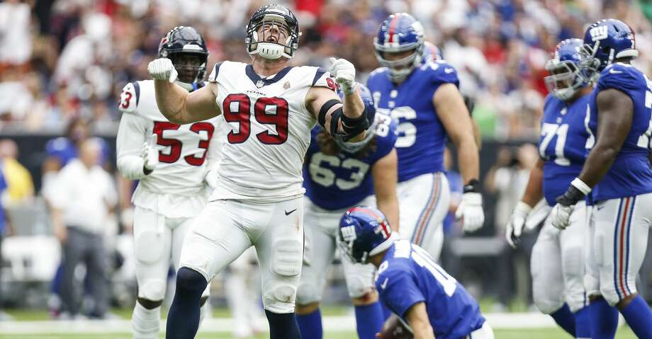 PHOTOS: Texans vs. Giants Houston Texans defensive end J.J. Watt (99) celebrates after sacking New York Giants quarterback Eli Manning (10) during the second half as the Houston Texans take on the New York Giants at NRG Stadium Sunday Sept. 23, 2018 in Houston. Browse through the photos to see action from the Texans' home opener against the Giants. Photo: Michael Ciaglo/Staff Photographer