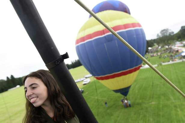 Greenwich's Abigail Kay, 14, looks out from a hot air balloon at the Greenwich Land Trust's 19th annual Go Wild! Family Field Day at the Greenwich Polo Club in Greenwich, Conn. Sunday, Sept. 23, 2018. The event featured a variety of fun outdoor activities including hot air balloon rides, bungee trampolines, a climbing wall, pick up soccer games and more, as well as a selection of food trucks. The event supports GLT's ongoing land stewardship efforts and general operational costs.