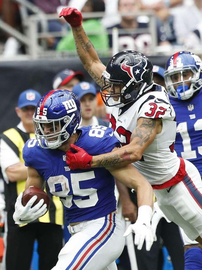 6d931f0c1 Houston Texans defensive back Tyrann Mathieu (32) tackles New York Giants  tight end Rhett