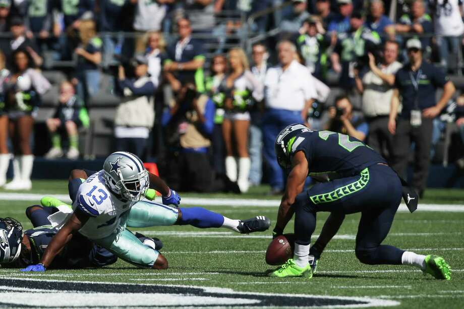 Seahawks safety Earl Thomas, right, recovers a pass intended for Cowboys wide receiver Michael Gallup (13) in the first quarter of Seattle's game against Dallas, Sunday, Sept. 23, 2018. Photo: GENNA MARTIN, SEATTLEPI.COM / SEATTLEPI.COM