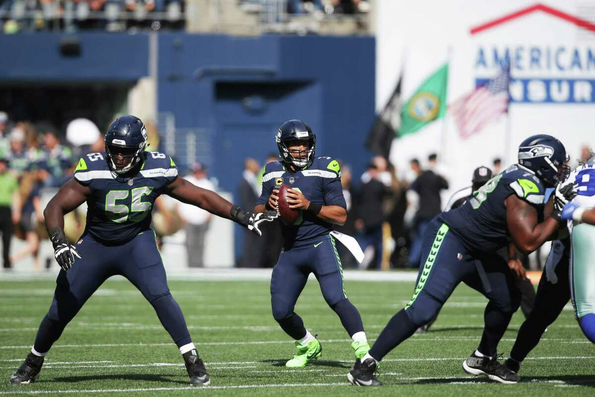 SEAHAWKS' O-LINE WINS BATTLE UP FRONT FOR FIRST TIME THIS SEASON Russell Wilson was sacked just twice against the Cowboys, a considerable improvement from the first two games far (He was sacked six times in both the opener against the Broncos and in Week 2 vs. the Bears). Wilson also seemed to have more more time in the pocket to find his receivers. With Joey Hunt filling in as the starting center, J.R. Sweezy stepping in at left guard and D.J. Fluker making his season debut at right guard, the Seahawks managed to subdue the Cowboys' strong defensive front. Coming into Sunday, Dallas ranked second in the NFL in forced sacks.