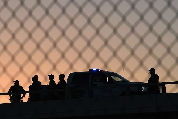 (FILES) In this file photo taken on February 17, 2016, US Border Patrol officers guard the border fence separating US and Mexico in the town of El Paso, Texas. - The US was to begin construction in Texas on September 22, 2018, of part of President Donald Trump's border wall designed to curb illegal immigration. Running along four miles (six kilometers) of the 2,000-mile (3,219-km) border with Mexico, the new section will replace existing fencing along the boundary between El Paso, Texas, and Ciudad Juarez, Mexico, US Customs and Border Protection said in a statement. (Photo by Mark Ralston / AFP)MARK RALSTON/AFP/Getty Images