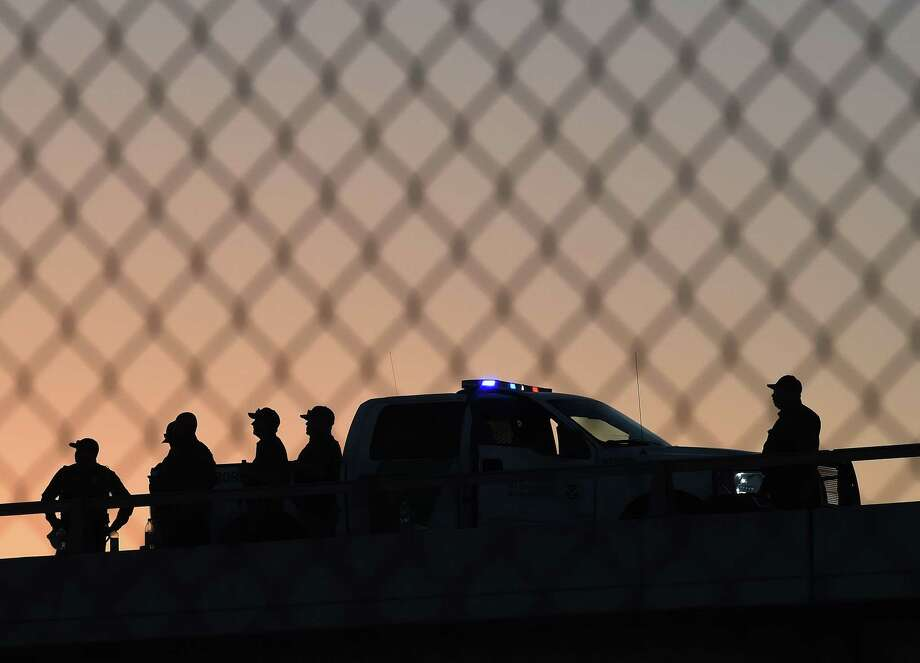 (FILES) In this file photo taken on February 17, 2016, US Border Patrol officers guard the border fence separating US and Mexico in the town of El Paso, Texas. - The US was to begin construction in Texas on September 22, 2018, of part of President Donald Trump's border wall designed to curb illegal immigration. Running along four miles (six kilometers) of the 2,000-mile (3,219-km) border with Mexico, the new section will replace existing fencing along the boundary between El Paso, Texas, and Ciudad Juarez, Mexico, US Customs and Border Protection said in a statement. (Photo by Mark Ralston / AFP)MARK RALSTON/AFP/Getty Images Photo: MARK RALSTON /AFP /Getty Images / AFP or licensors