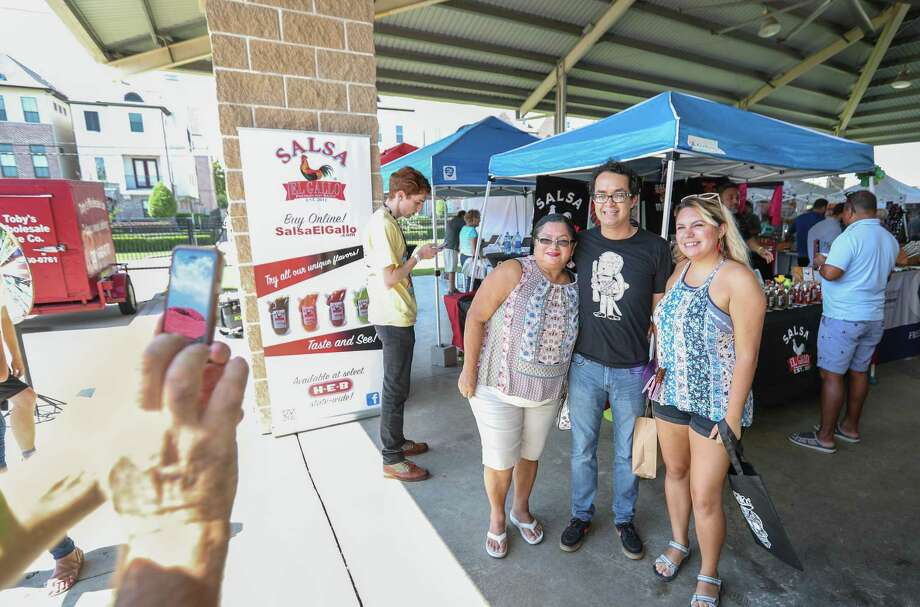 """MasterChef"" contestant Cesar Cano (center) stops to have his photo taken with fans as he shopped at the 2018 Texas Hot Sauce Festival Sunday, Sept. 23, 2018, in Houston. The two day event was held at the Bayou City Event Center featured hundreds of hot and spicy products from around the country. Photo: Steve Gonzales, Houston Chronicle / Staff Photographer / © 2018 Houston Chronicle"