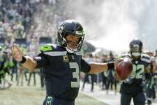Seahawks quarterback Russell Wilson gestures to the crowd before the start of Seattle's game against Dallas, Sunday, Sept. 23, 2018.