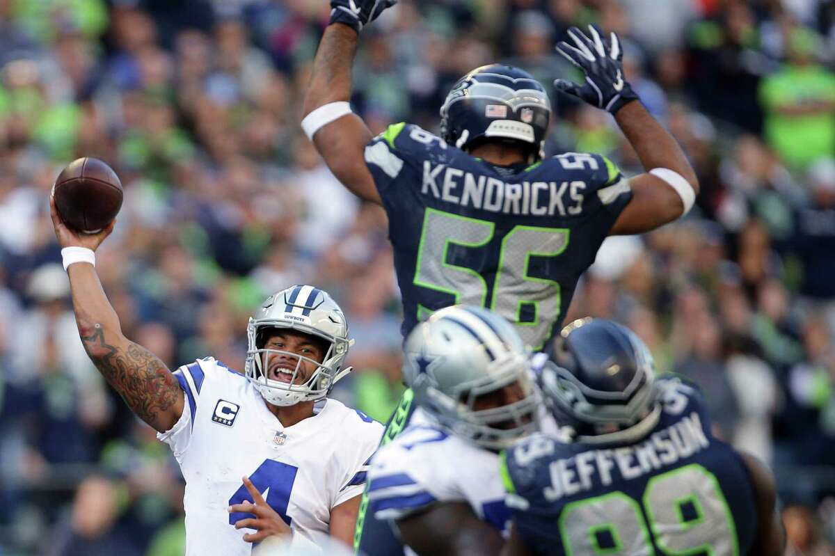 Seahawks linebacker Mychal Kendricks (56) attempts to block a pass by Cowboys quarterback Dak Prescott in the second half of Seattle's game against Dallas, Sunday, Sept. 23, 2018.