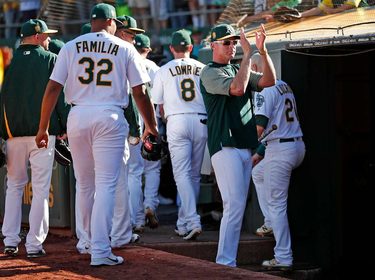 Oakland Athletics' manager Bob Melvin applauds the fans after final regular season home game of the season, a 5-1 loss to the Minnesota Twins, at Oakland Coliseum in Oakland, Calif. on Sunday, September 23, 2018.