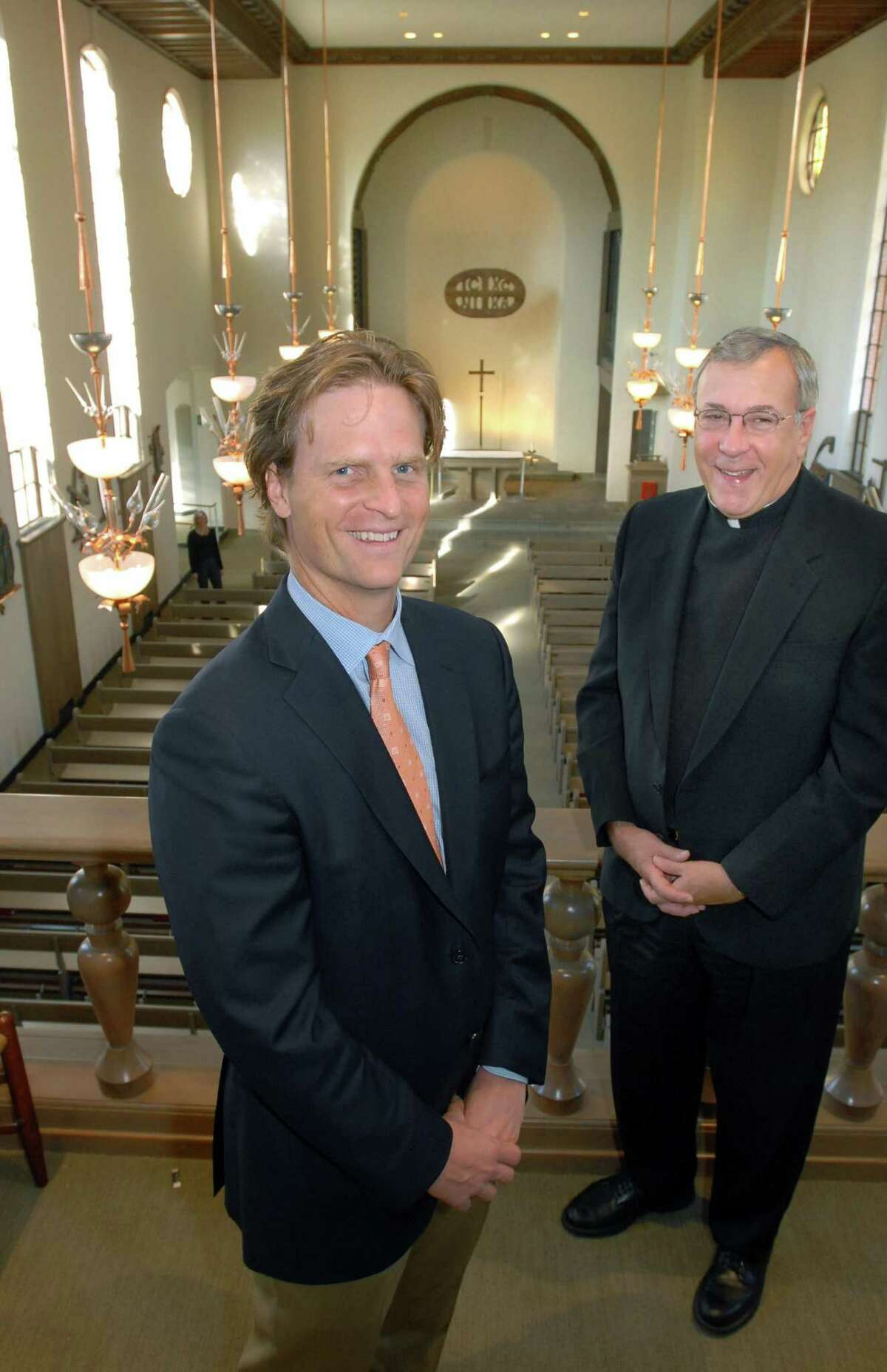 The Rev. Robert Beloin, right, with architect George Knight, who oversaw the renovation of Saint Thomas More Chapel at Yale.