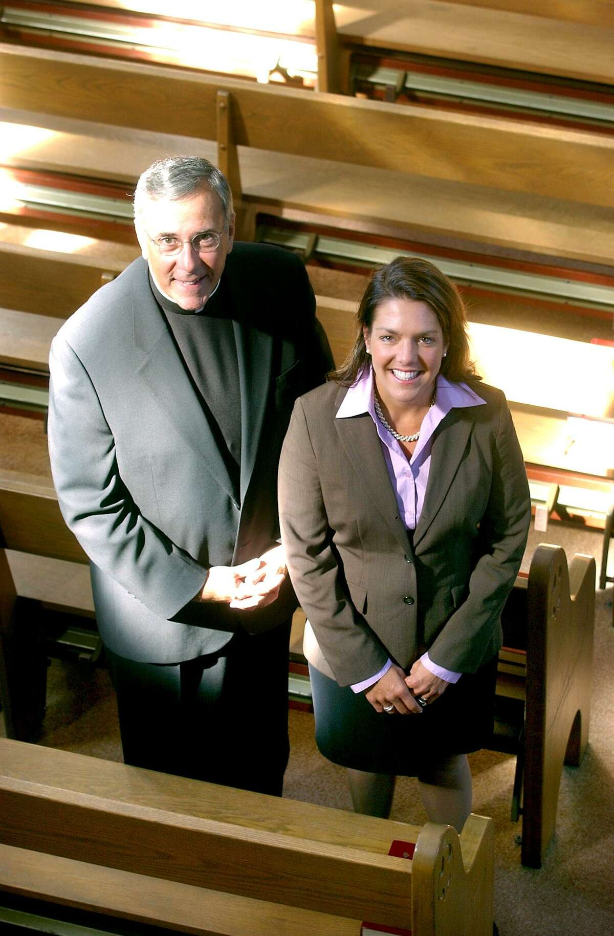 Rev. Robert Beloin with Kerry Robinson at St. Thomas More Catholic Chapel and Center in 2004.