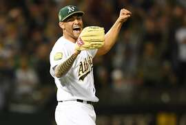 OAKLAND, CA - APRIL 21:  Sean Manaea #55 of the Oakland Athletics celebrates after pitching a no-hitter against the Boston Red Sox at the Oakland Alameda Coliseum on April 21, 2018 in Oakland, California. The Athletics won the game 3-0.  ~~