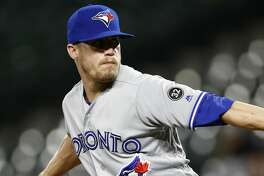 Toronto Blue Jays relief pitcher Ken Giles throws to the Baltimore Orioles in the ninth inning of a baseball game, Tuesday, Sept. 18, 2018, in Baltimore. (AP Photo/Patrick Semansky)