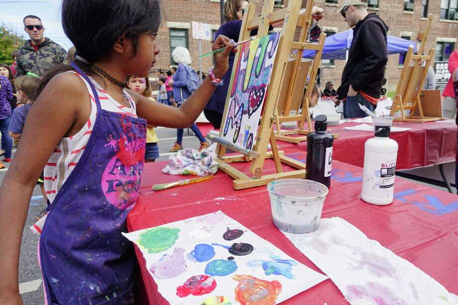 Maya Chittur, 8, of Albany paints on a canvas at the annual Upper Madison Street Fair on Sunday, Sept. 23, 2018, in Albany, N.Y.   (Paul Buckowski/Times Union) Photo: Paul Buckowski / (Paul Buckowski/Times Union)