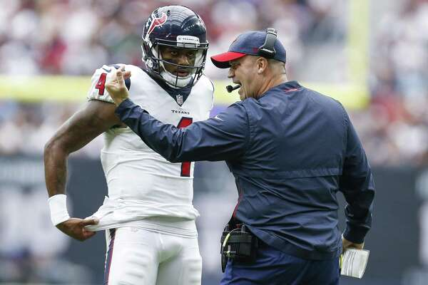 Texans coach Bill O'Brien, right, must figure out a way to keep quarterback Deshaun Watson in one piece against the Jaguars' intense pass rush Sunday.