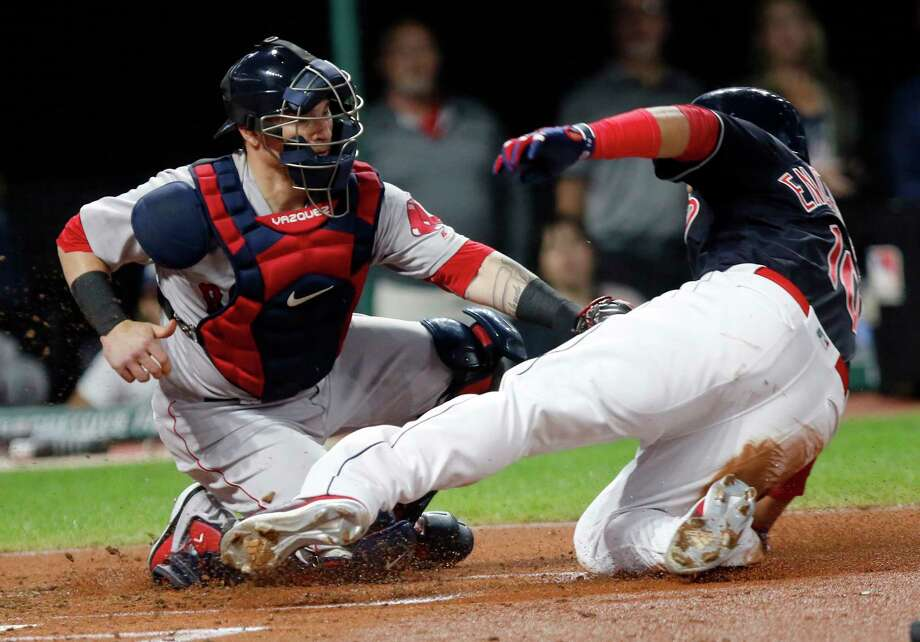 Boston Red Sox catcher Christian Vazquez, left, tags out Cleveland Indians' Edwin Encarnacion at home plate on a fielder's choice hit into by Josh Donaldson in the second inning of a baseball game, Sunday, Sept. 23, 2018, in Cleveland. (AP Photo/Tom E. Puskar) Photo: Tom E. Puskar / Copyright 2018 The Associated Press. All rights reserved