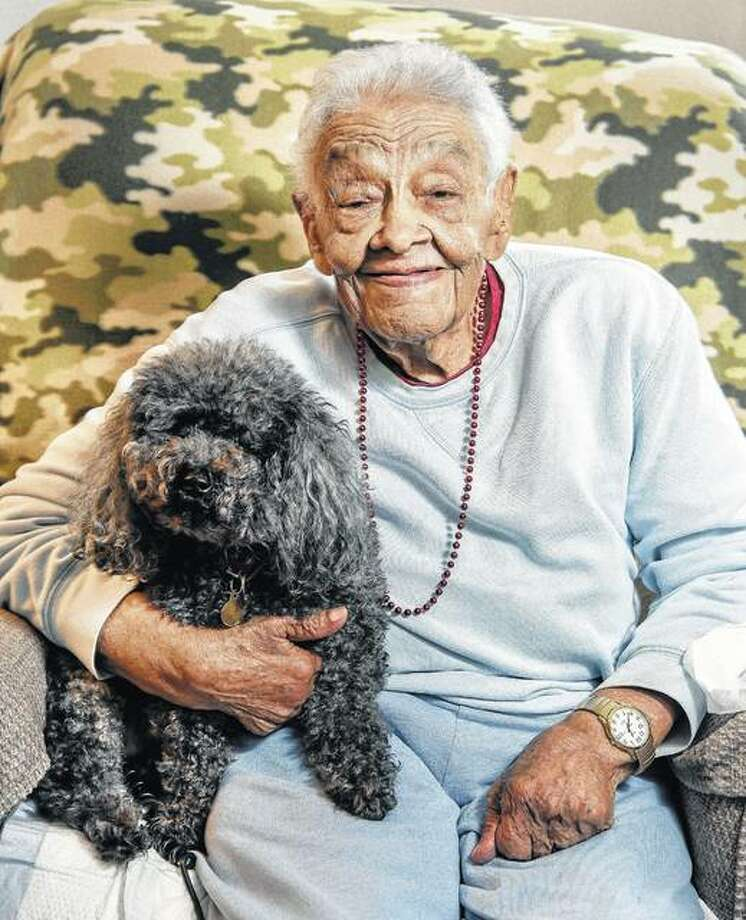 Former educator Teretha Johnson sits with her 14-year-old poodle, Satchel, at her home in Savoy. Johnson was Champaign's first African American teacher. She taught through two world wars, prohibition, Brown v. Board of Education and the end of segregation. Photo: Rick Danzl | News-Gazette (AP)