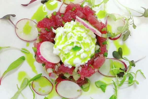 In the tuna tartare, he velvety texture of minced fish contrasts with crunchy radish discs and chopped cucumber.