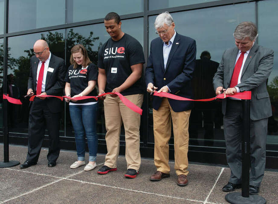 From left: SIUE College of Arts and Sciences Dean Greg Budzban, students Courtney Vahle and Mohamed Hassan, Senator Bill Haine and SIUE Chancellor Randy Pembrook participate in the ribbon-cutting at the renovated Science East Building. Photo: SIUE Photo
