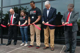 From left: SIUE College of Arts and Sciences Dean Greg Budzban, students Courtney Vahle and Mohamed Hassan, Senator Bill Haine and SIUE Chancellor Randy Pembrook participate in the ribbon-cutting at the renovated Science East Building.