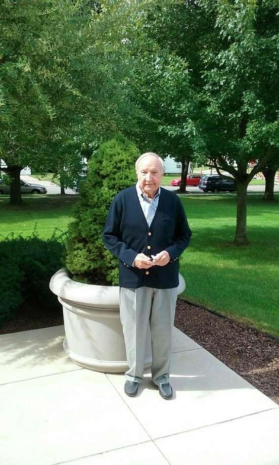 Lou Garl has spent 60 years working for Northwestern Mutual Life. (John Kennett/jkennett@mdn.net)