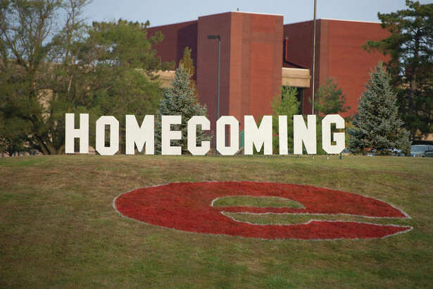 Homecoming letters on the hill in front of the Morris University Center.