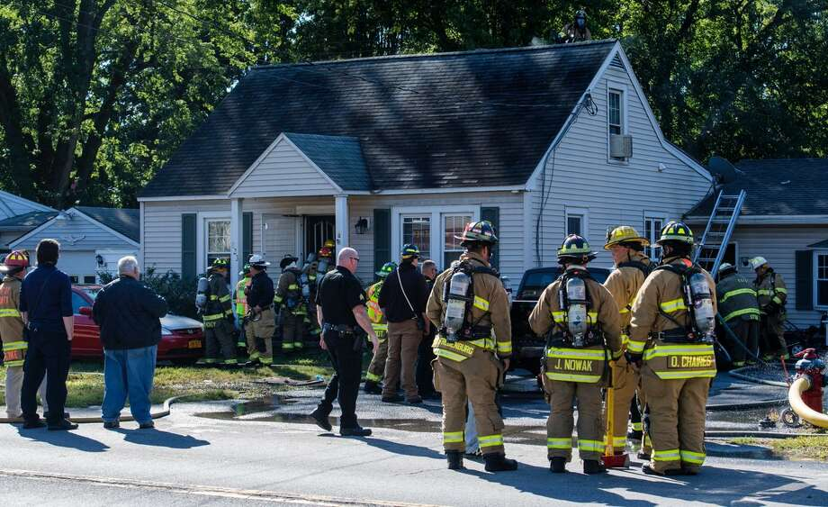 Firefighters in Rotterdam battled a house fire and saved pets - giving one cat CPR - Monday morning in Rotterdam. Photo: Skip Dickstein / Times Union