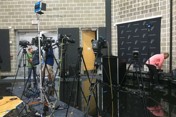 Players and coaches are speaking to reporters at the Spurs' media day on Monday, Sept. 24, 2018.