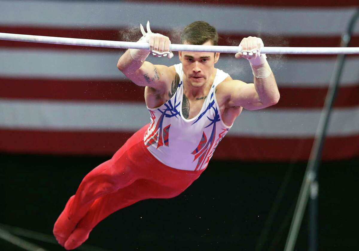 Colin Van Wicklen competes on the high bar at the U.S. Gymnastics Championships, Thursday, Aug. 16, 2018, in Boston. (AP Photo/Elise Amendola)