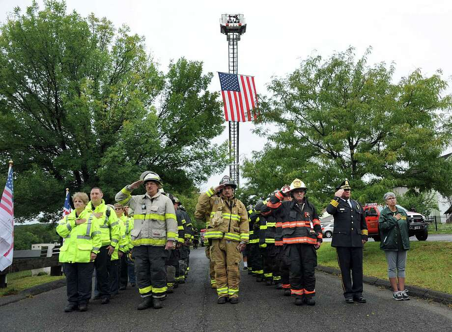 New Milford firefighters and police participate in a 9/11 memorial ceremony in New Milford on Sept. 11. The day marked the 17th anniversary of the terrorist attack on the World Trade Center. Photo: Carol Kaliff / Hearst Connecticut Media / The News-Times