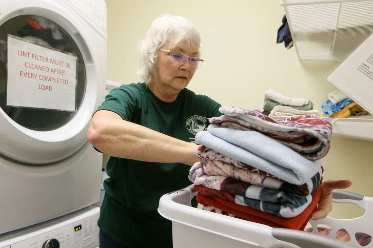 Linda Lamberth, a level 4 rescue volunteer at Wildlife Rescue & Rehabilitation's Roger and Phyllis Sherman Animal Care Complex at 1354 Basse Rd., works in the laundry room on Friday, Sept. 21, 2018.