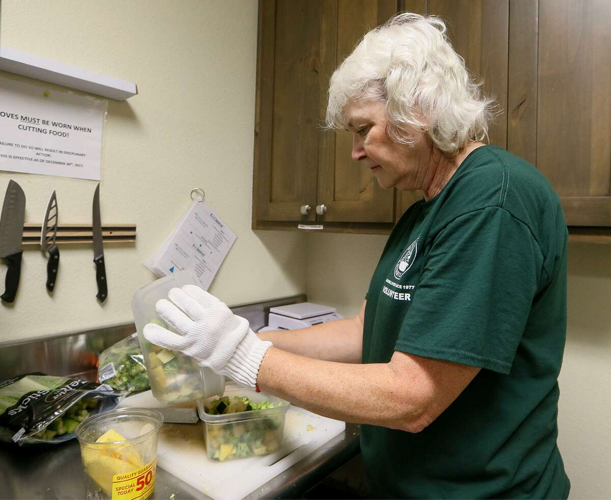Linda Lamberth, a level 4 rescue volunteer at Wildlife Rescue & Rehabilitation's Roger and Phyllis Sherman Animal Care Complex at 1354 Basse Rd., prepares food for squirrels on Friday, Sept. 21, 2018.