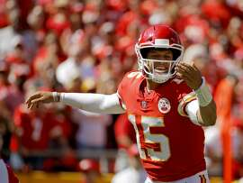 Kansas City Chiefs quarterback Patrick Mahomes (15) calls a play during the first half of an NFL football game against the San Francisco 49ers in Kansas City, Mo., Sunday, Sept. 23, 2018. (AP Photo/Charlie Riedel)