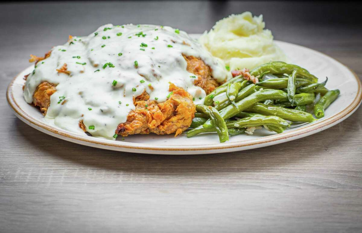 Chicken fried rib-eye steak with mashed potatoes and green beans at Killen's Barbecue