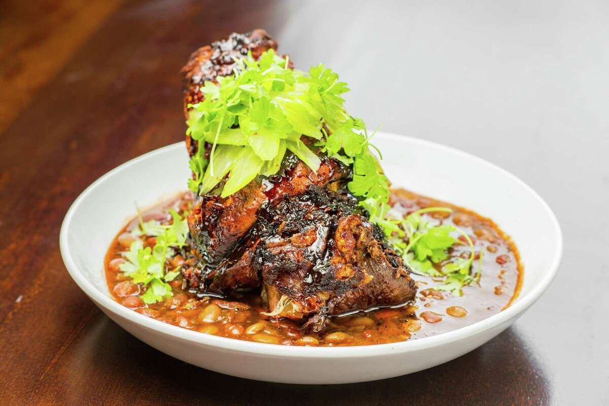 Crispy pork shank with braised seasonal beans and pickled celery at Kulture