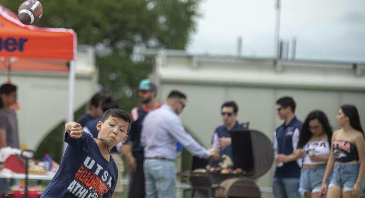 Cadyn Noriega, 10, plays football before the Roadrunner's game against Texas University on Saturday, September, 22, 2018.