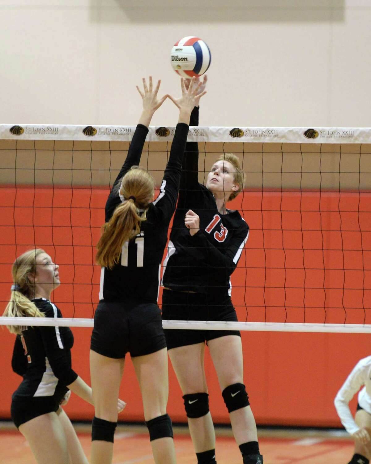 Elena Welsh (13) of St. John XXIII attempts a kill shot in the second set of a high school volleyball match between the St. John XXIII Lions and the Incarnate Word Falcons on September 4, 2018 at St. John XXIII College Preparatory, Katy, TX.