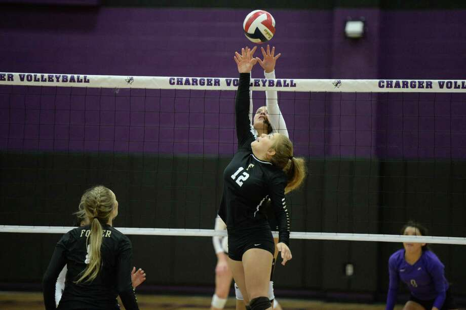 Briana Creery (12) of Foster and Ellie Echter (11) of Fulshear vie for the ball in the second set of a high school volleyball game between the Fulshear Chargers and the Foster Falcons on September 12, 2017 at Fulshear High School, Fulshear, TX. Photo: Craig Moseley, Staff / Houston Chronicle / ©2017 Houston Chronicle