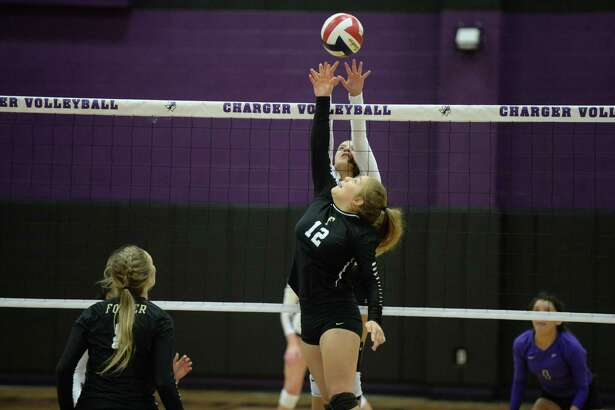 Briana Creery (12) of Foster and Ellie Echter (11) of Fulshear vie for the ball in the second set of a high school volleyball game between the Fulshear Chargers and the Foster Falcons on September 12, 2017 at Fulshear High School, Fulshear, TX.