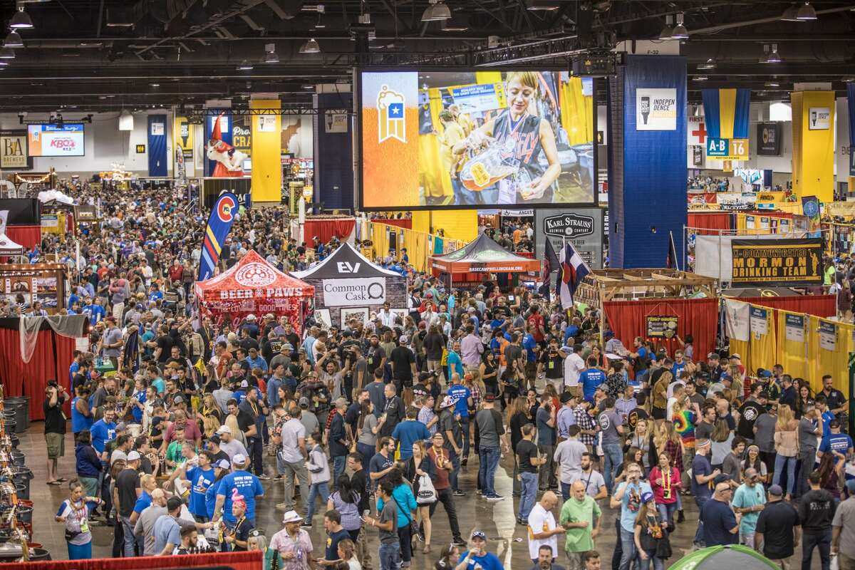 Vendors pour for fest-goers at the 2018 Great American Beer Festival in Denver, Colorado.