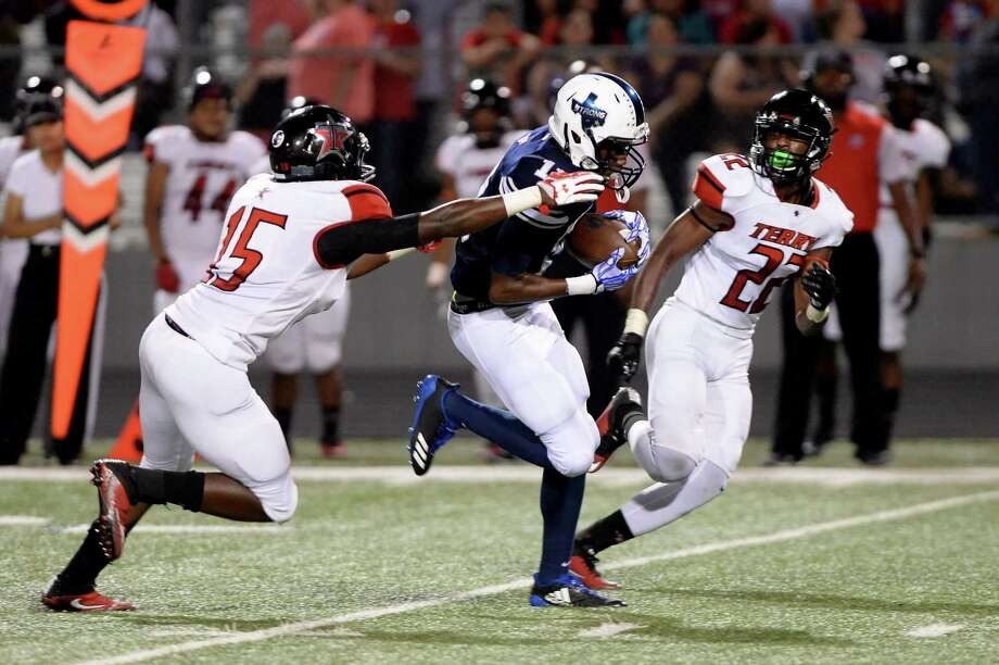 Cameron Dotson (11) of Lamar Consolidated pulls in a catch in the second quarter of a high school football game between the Lamar Consolidated Mustangs and the Terry Rangers on October 6, 2017 at Traylor Stadium, Rosenberg, TX. Photo: Craig Moseley, Staff / Houston Chronicle / ©2016 Houston Chronicle