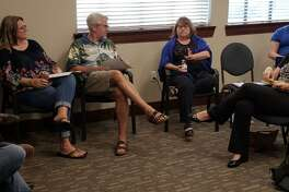 Bee Moorhead, center, director of the Texas Interfaith Center for Public Policy, shares an idea with the Talanoa dialogue group that met Sept. 18 in Cinco Ranch.