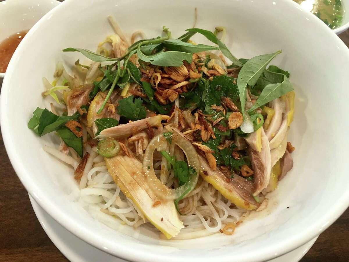 Dry chicken pho with a side of broth at Pho Ga Dong Nai