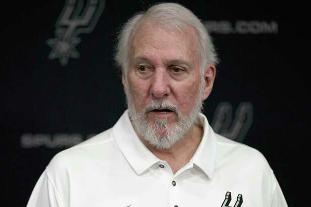 San Antonio Spurs NBA basketball head coach Gregg Popovich answers questions from reporters during media day at the Spurs practice facility in San Antonio, Monday, Sept. 24, 2018. (AP Photo/Darren Abate)
