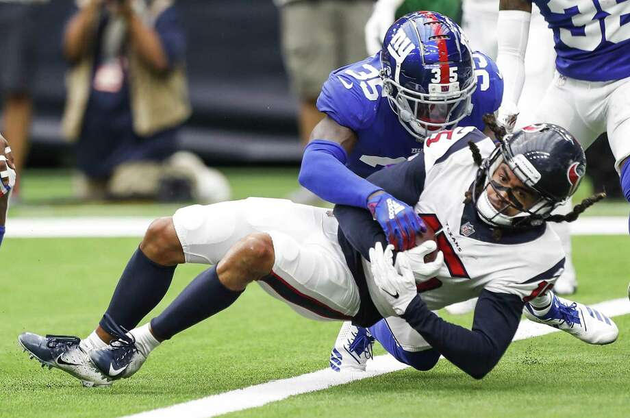 Houston Texans wide receiver Will Fuller (15) is tackled by New York Giants cornerback Curtis Riley (35) as he falls into the end zone for 6-yard touchdown reception during the fourth quarter of an NFL football game at NRG Stadium on Sunday, Sept. 23, 2018, in Houston. Photo: Brett Coomer, Houston Chronicle / Staff Photographer / © 2018 Houston Chronicle