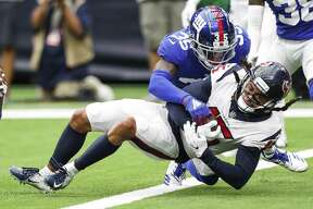 Houston Texans wide receiver Will Fuller (15) is tackled by New York Giants cornerback Curtis Riley (35) as he falls into the end zone for 6-yard touchdown reception during the fourth quarter of an NFL football game at NRG Stadium on Sunday, Sept. 23, 2018, in Houston.