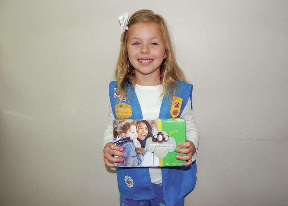 GSofSI Girl Scout Alvina Farley displays a box of Girl Scout candy. Photo: For The Intelligencer