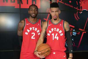 Toronto Raptors NBA basketball players Kawhi Leonard, left, and Danny Green pose for a photo during media day in Toronto, Monday, Sept. 24, 2018. (Chris Young/The Canadian Press via AP)