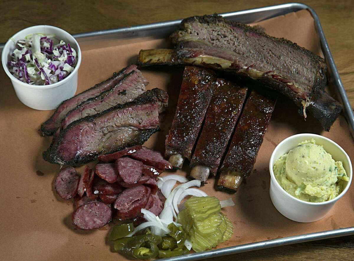 Where to get barbecue that Houstonians brag about:  A slab of beef rib, brisket, jalapeno sausage, glazed pork ribs, cole slaw and potato salad is seen here from Pinkerton's Barbecue. There are too many BBQ places in Houston to choose from so here is a handy guide to getting the meat sweats.