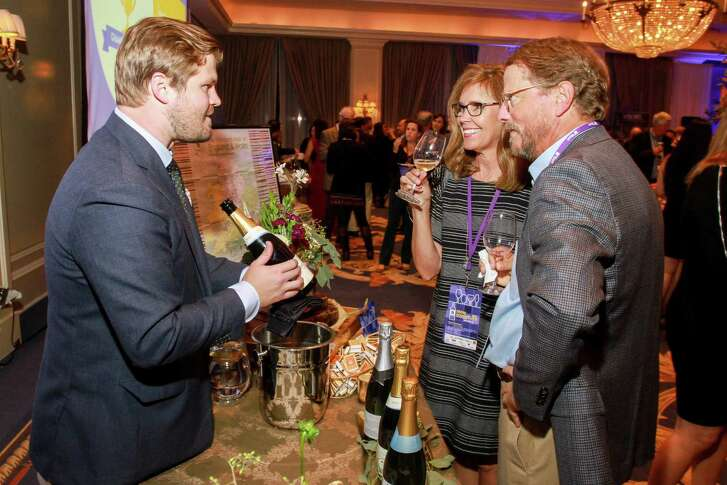 Sommelier Matt Crawford, left, with Lori and Beau Glenn at the Iron Sommelier event at the Houstonian in 2017.