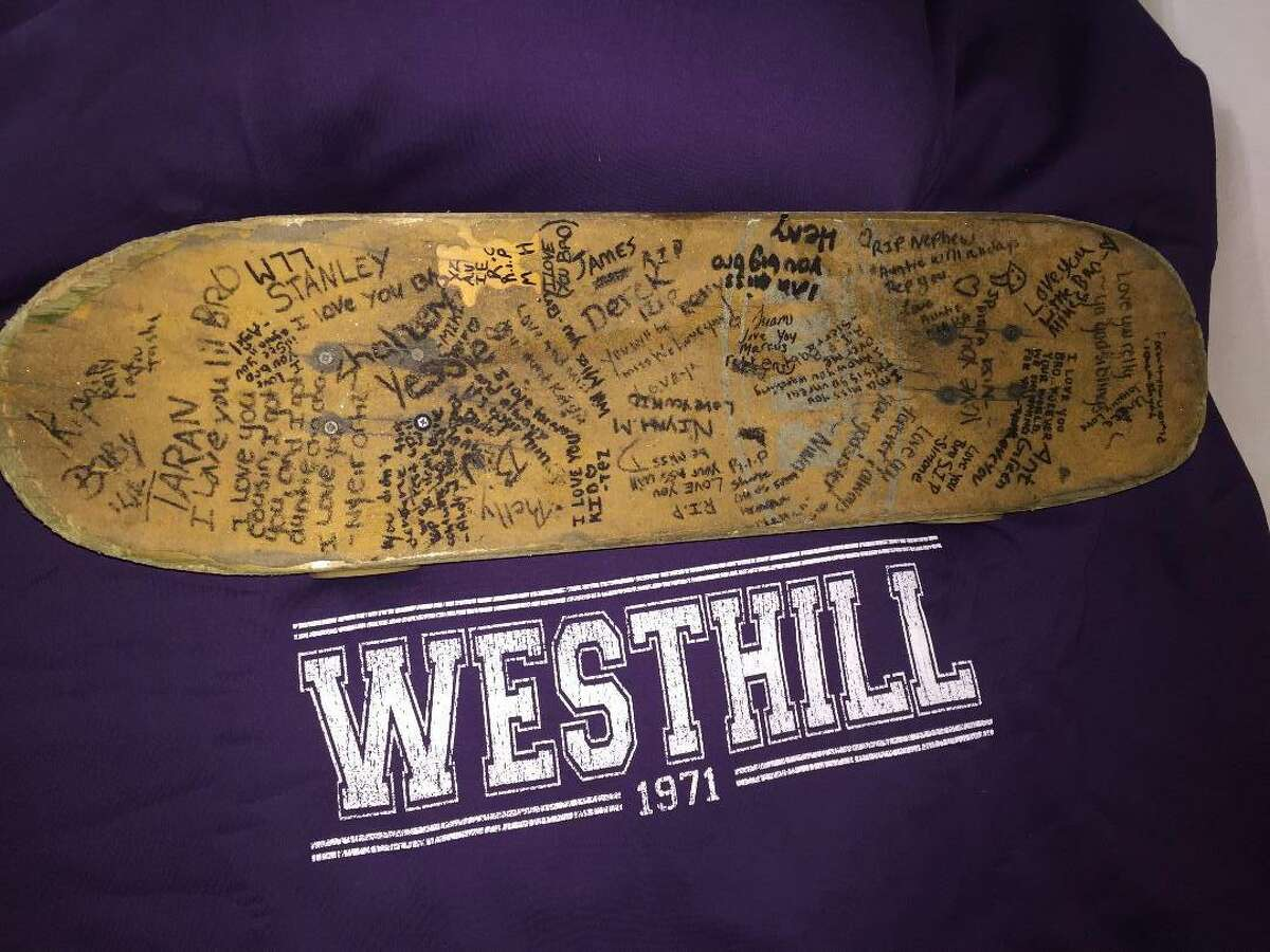 Marcus Hall's skateboard, signed by friends and family after Hall died on Saturday, Sept. 22, two days after he was shot at Southwood Square Apartments in Stamford's West Side neighborhood.