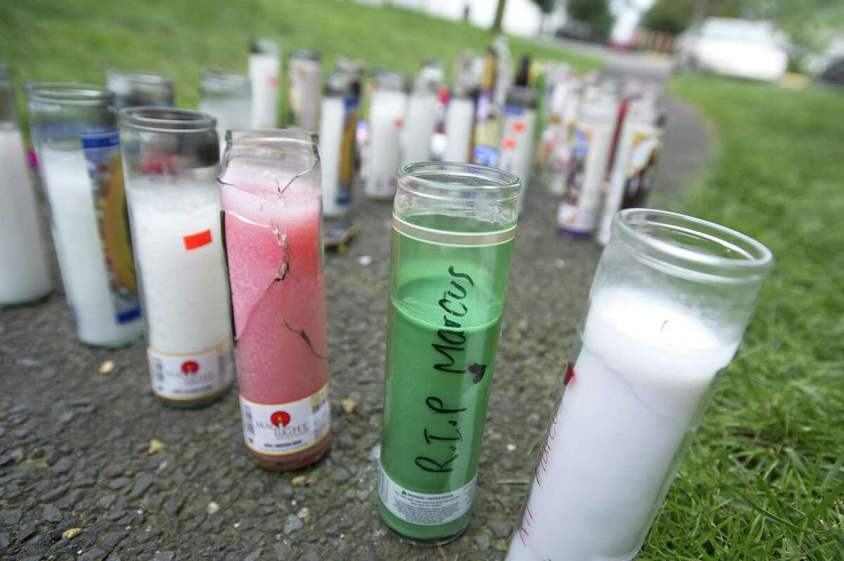 Candles sit outside the Southwood Square Apartments in memory of Marcus Hall, the 16-year-old Stamford resident who was fatally shot on Thursday, in Stamford, Conn. on Monday, Sept. 24, 2018.